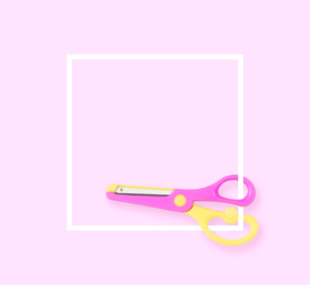 Minimal white layout yellow and pink scissors isolated pink pastel