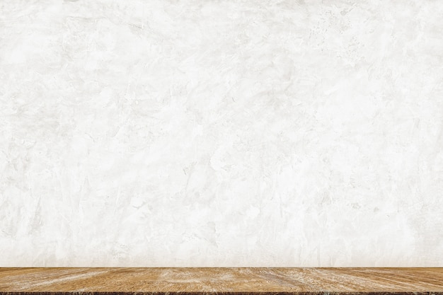 Minimal wood table top on white concrete paint wall