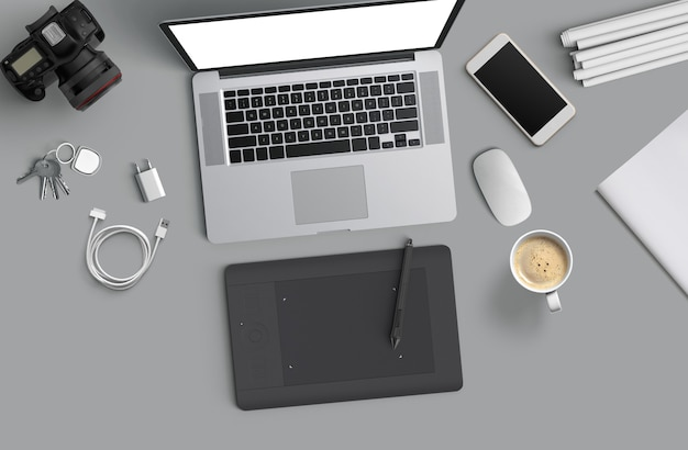 Minimal work space : laptop, camera, coffee, camera, pen, pencil, notebook, smartphone stationery on gray background for copy space flat lay top view