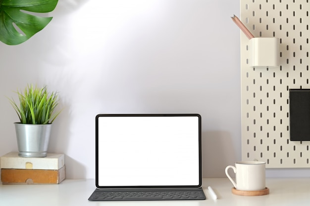 Minimal workplace with mockup blank screen tablet