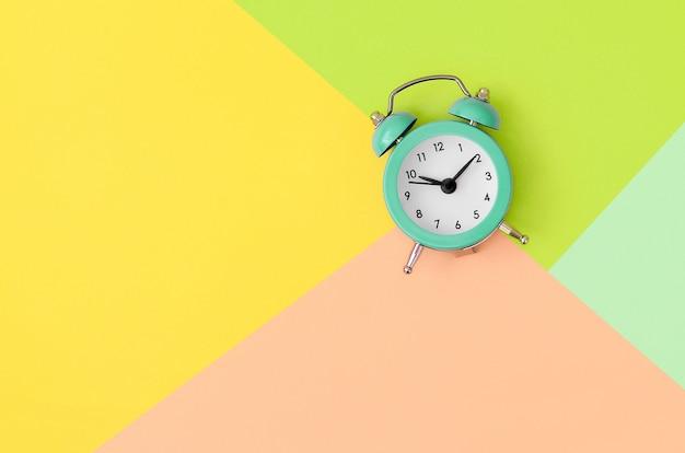 Minimalism flat lay top view. alarm clock
