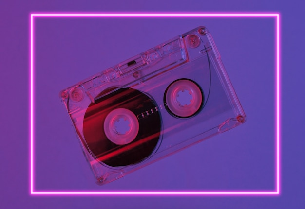 Minimalism retro style concept. 80s. audio cassette in neon red blue light. retro wave