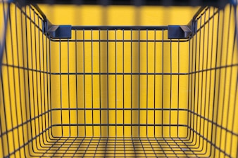Minimalism style, Shopping cart black color and yellow wall at supermarket.
