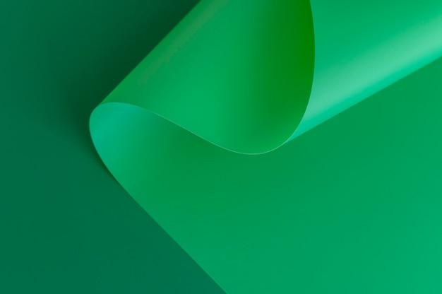 녹색 종이의 미니멀 추상 소용돌이