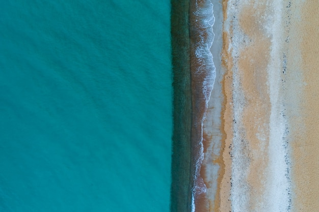 Minimalist aerial landscape. turquoise water and sandy beach with copy space