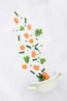 Minimalist arrangement of different ingredients on white background