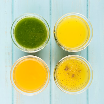 Minimalist assortment of fresh smoothies close-up