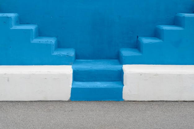 Minimalist background texture stairs. trendy color of the year 2020. selective view of the outdoor staircase with blue background. minimalist concept.