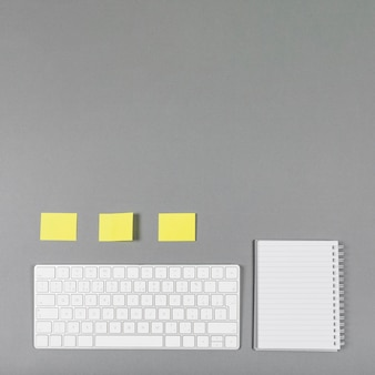 Minimalist business arrangement on grey background with copy space