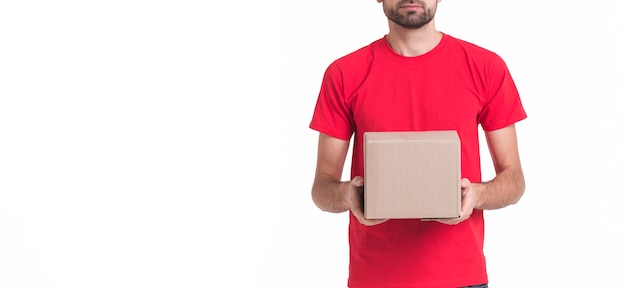 Minimalist copy space background with man holding a package