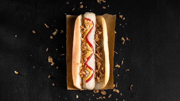 Minimalist fast-food hot dog flat lay