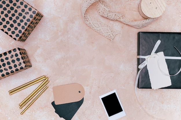 Minimalist girly gifts on marble background with copy space