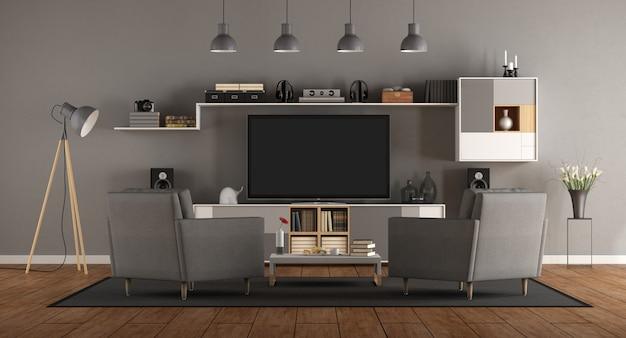 ホームシネマシステムを備えたシンプルなグレーの部屋
