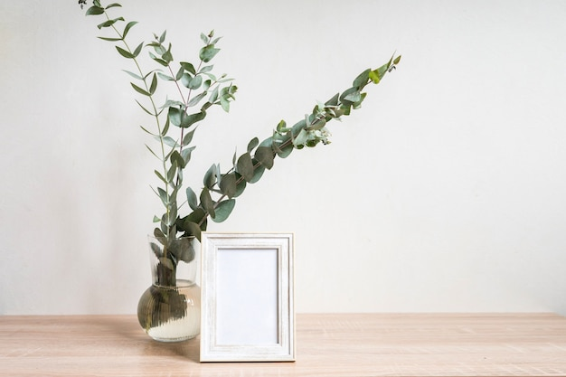 Minimalist home decor with empty frame mockup on white wall background