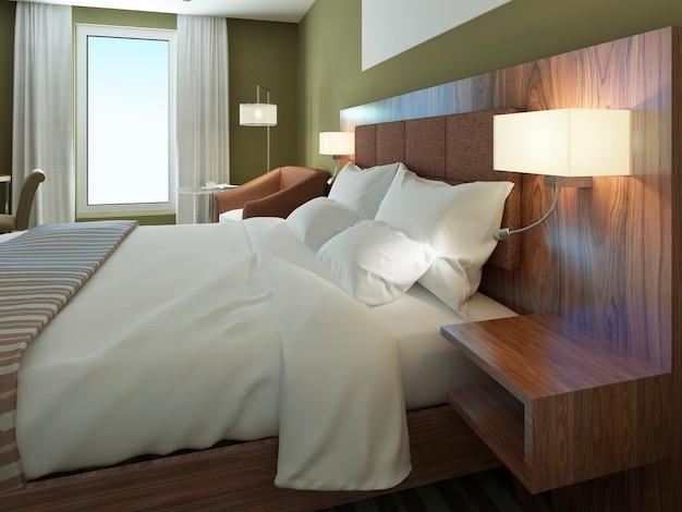 아름다운 옷을 입은 더블 침대가있는 미니멀리스트 호텔 객실