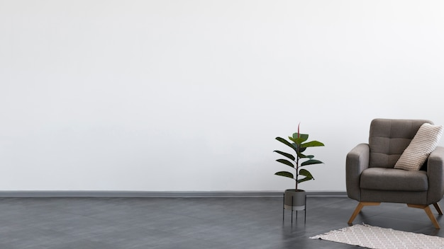 Минималистский дизайн гостиной с креслом и растением