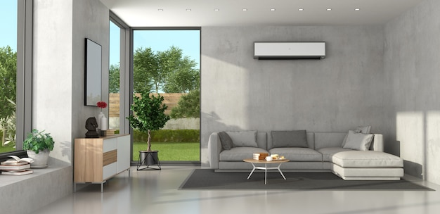Minimalist living room with modern furniture and air conditioner on wall