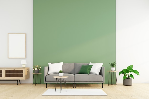 소파와 사이드 테이블, 녹색 벽 및 녹색 식물이 있는 미니멀한 거실. 3d 렌더링