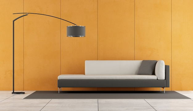 Minimalist living room with sofa and orange wall. 3d rendering