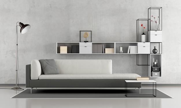 ソファとコンクリートの壁にモダンな本棚があるシンプルなラウンジ