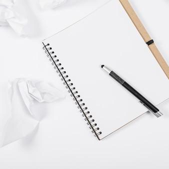 Minimalist office arrangement with empty notebook