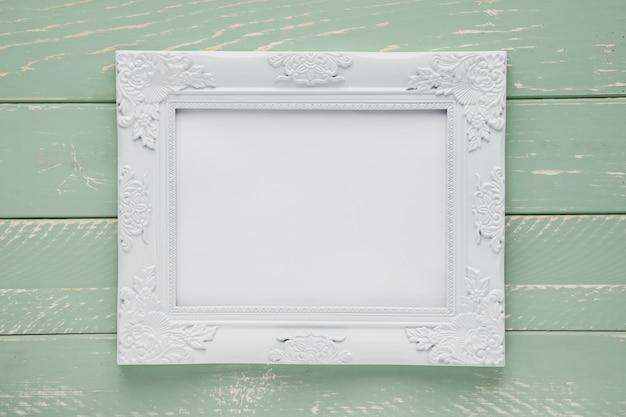 Minimalist ornamental frame on wooden background