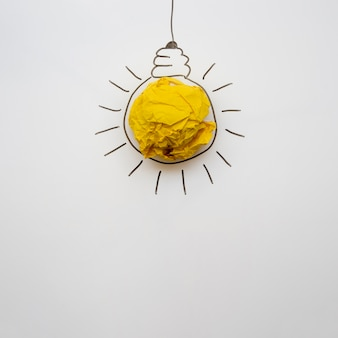 Minimalist paper light bulb with copy space