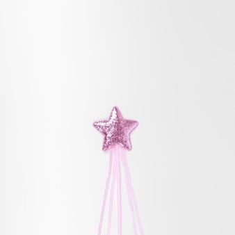 Minimalist pink star on white background