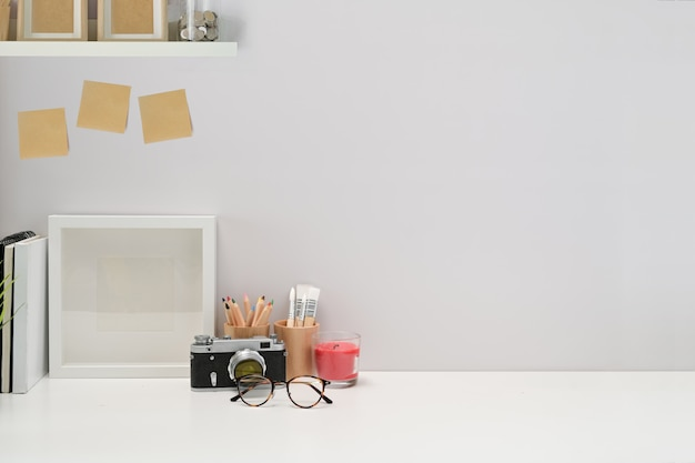 Minimalist stylish workspace poster, home office supplies, vintage camera and copy space