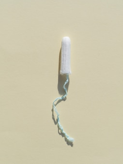 Minimalist tampon on grey background top view