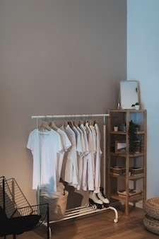 Minimalist wardrobe in corner of room