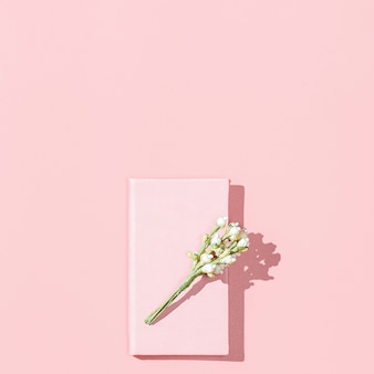 Minimalistic card mockup with empty pink notebook