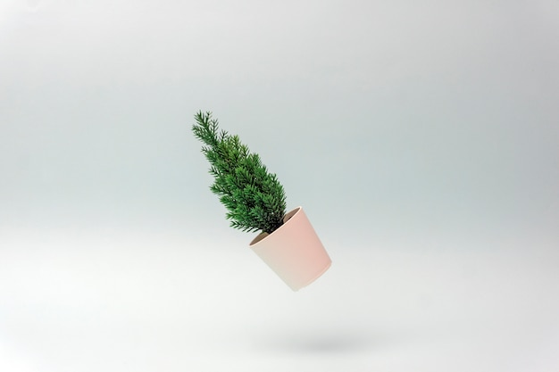 Minimalistic christmas tree on a blue background. new year concept. flat lay, copy space