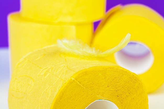 Minimalistic composition of bright yellow toilet paper rolls