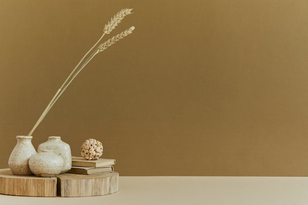 Minimalistic composition of cozy interior design with copy space, natural materials as wood and marbel, dry plants and personal accessories. neutral and yellow colors, template.