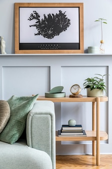 Minimalistic composition of living room with design sofa, coffee table, plant, books, decoration, pillows, plaid, carpet, wood paneling and elegant personal accessories in stylish home decor.