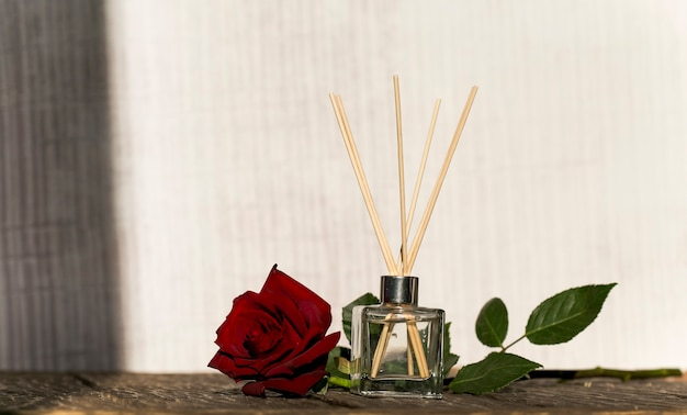 Minimalistic composition with aroma sticks and aroma oil copy space