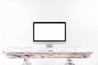 Minimalistic computer standing on vintage desk