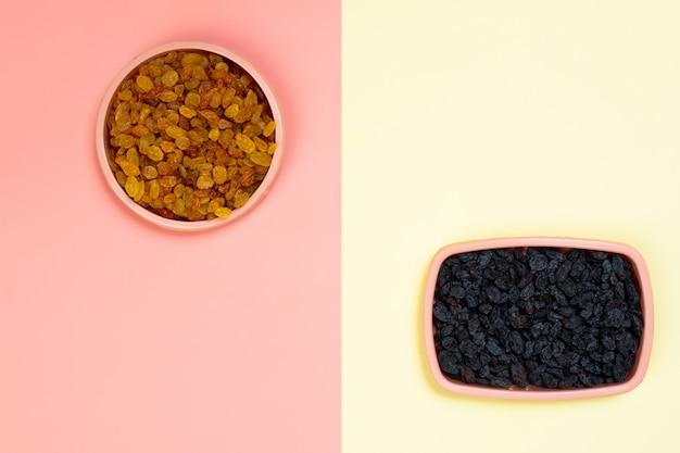 Minimalistic flat bark with plastic plates with yellow and black raisins