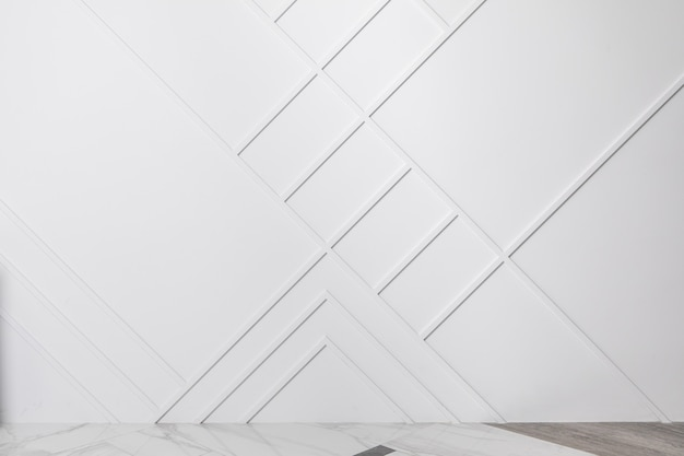 Minimalistic modern interior. part of room - floor and wall decorated with moldings. background with free copyspace