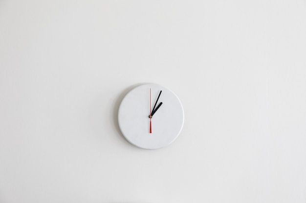 A minimalistic modern white clock without numbers