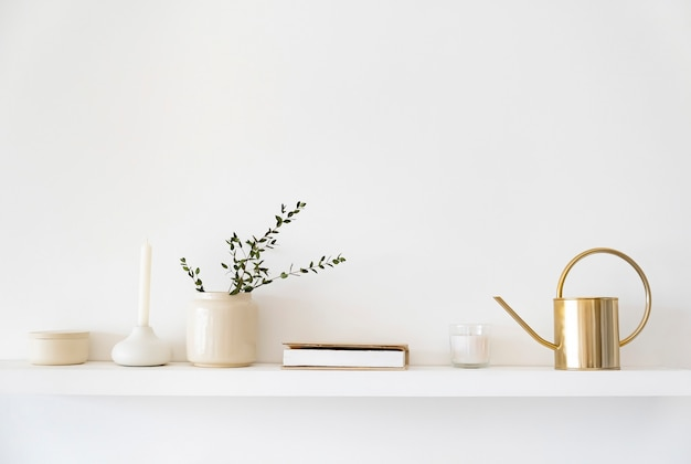 Minimalistic scandinavian interior. dishes on white shelves. white details in the interior.