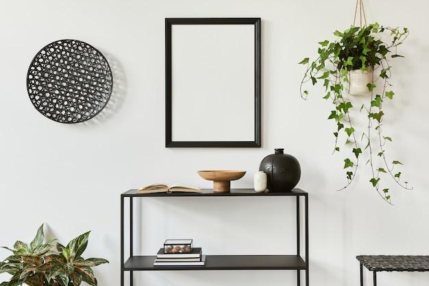 モックアップポスターフレーム、金属棚、植物、個人用アクセサリーを備えたクリエイティブな部屋のインテリアデザインのミニマルでスタイリッシュな構成。黒と白のコンセプト。レンプレート。