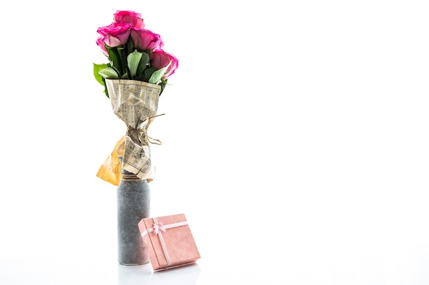 Minimalistic vase of roses and small gift