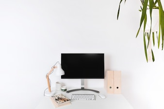 Minimalistic wooden workplace with blank monitor