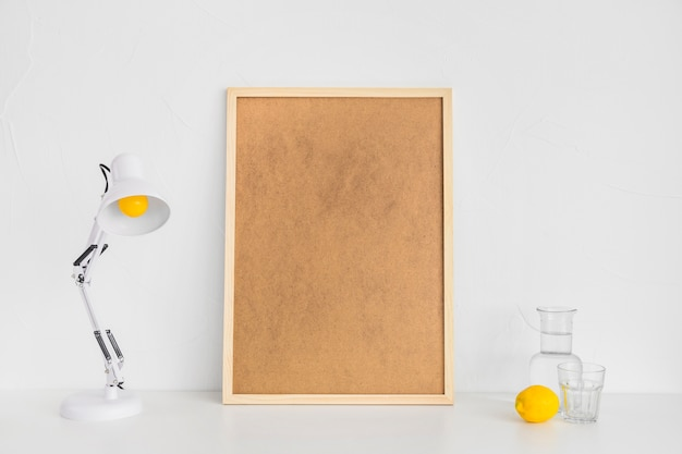 Minimalistic workplace with cork board and lemon
