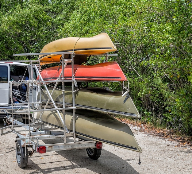 Minivan with four kayaks in trailer