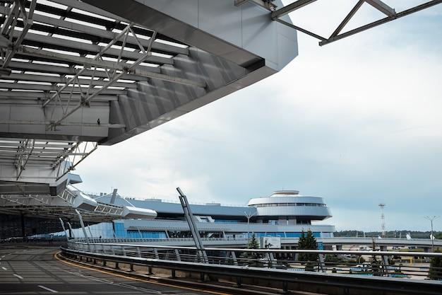 Minsk, belarus - june 16, 2021 minsk international airport. the main entrance to the terminal. international passenger transportation.