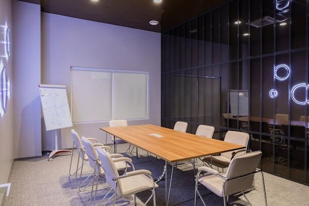 Minsk, belarus - may 23, 2019: interior of empty modern board room at creative office