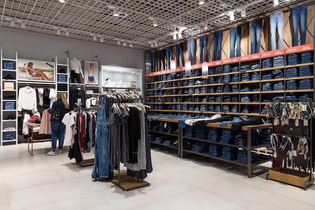 Minsk, belarus - may 29, 2019: interior shot of racks with shirts, undershirts and jeans